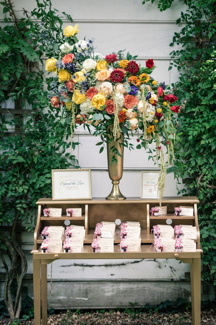 Escort cards were made by the bride and were attached to a variety of jarred jams.