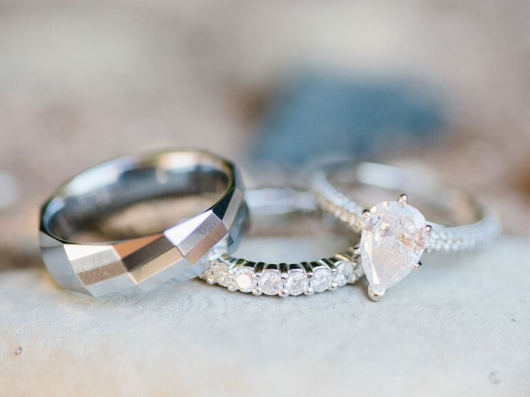 Teardrop engagement ring with wedding bands