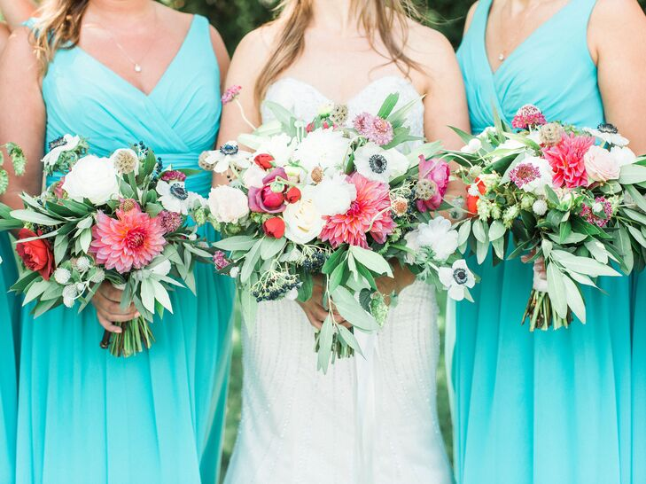 Bridesmaids wore turquoise dresses and carried lush arrangements of dahlias, anemones and greens. Other blooms included ranunculus, garden roses, hops and peonies.