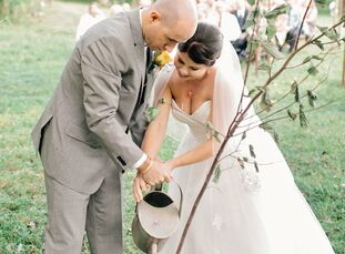 A neutral color palette of gray, ivory, blue, green and yellow along with vintage-inspired DIY touches brought the couple's elegant, organic nuptials