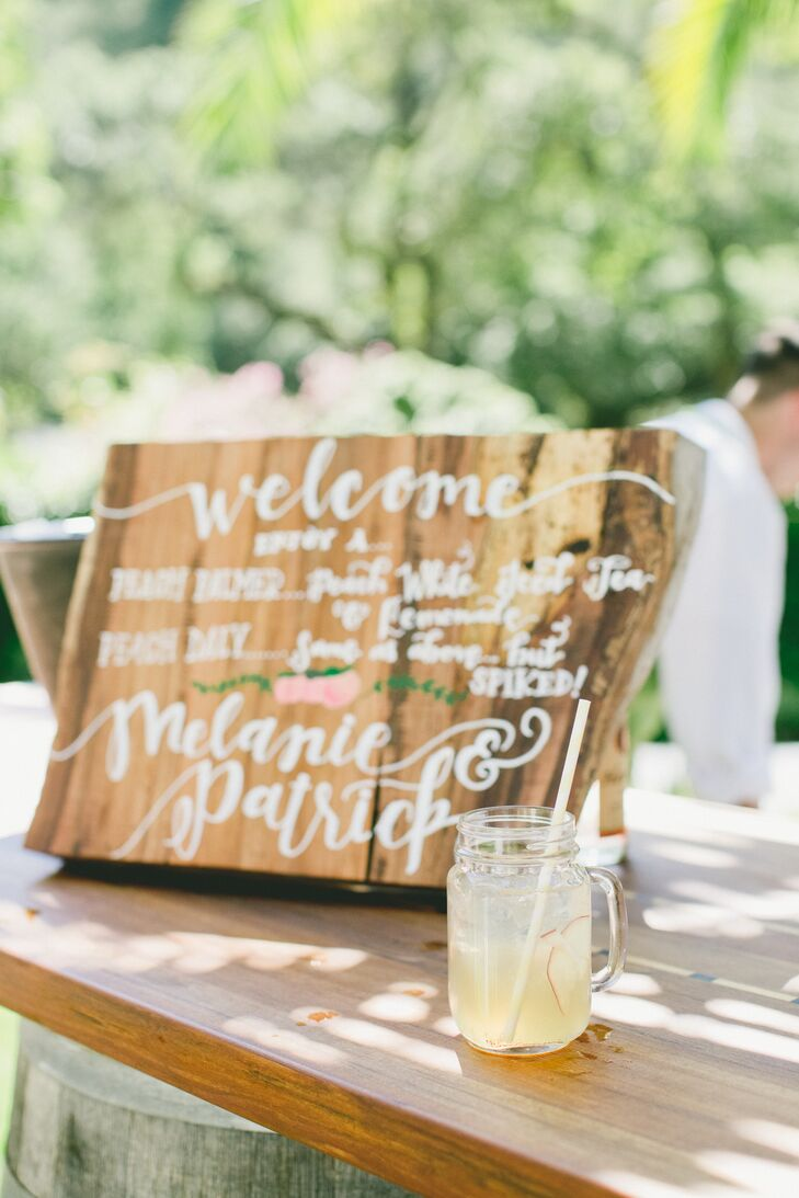 As guests arrived to the ceremony in Kenwood, California, they were given welcome drinks before Melanie and Patrick exchanged vows. Cocktails included a Peach Palmer (spiked peach lemonade), manhattans and an apricot gin and tonic.