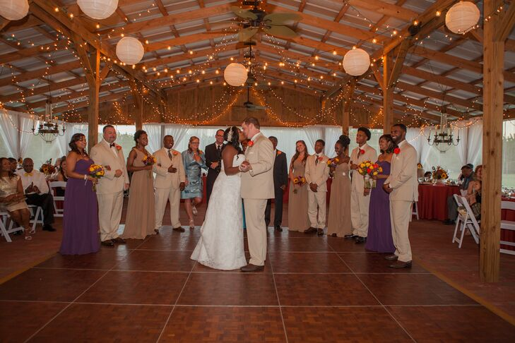 Newlywed First Dance Surrounded by Wedding Party and Family