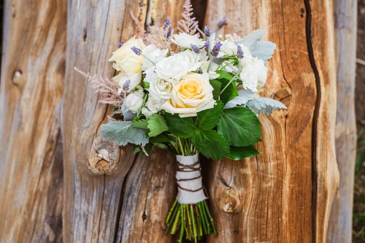 For the bridal bouquet, Sasha chose flowers that were grown in Breckenridge, Colorado. Cream roses, dusty miller and assorted wildflowers made for a beautiful arrangement from Petal and Bean.