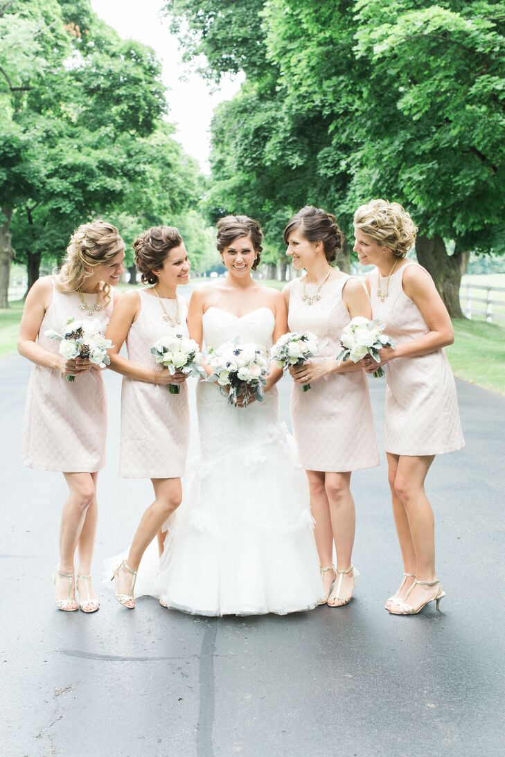 The bride's dress was elegant, yet playful, with varying fabrics, textures and layers. The beaded gemstones embroidered on her silk sash were the perfect addition to the dress, which she found after selecting the ribbon. The bridesmaids wore pink dresses from Ann Taylor with necklaces from Banana Republic and gold strappy sandals.