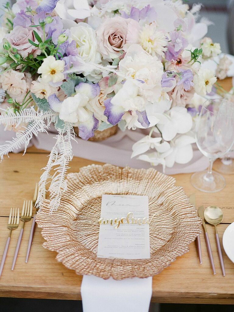 Pastel pink, purple and ivory flower centerpieces with rose gold accents at summer wedding