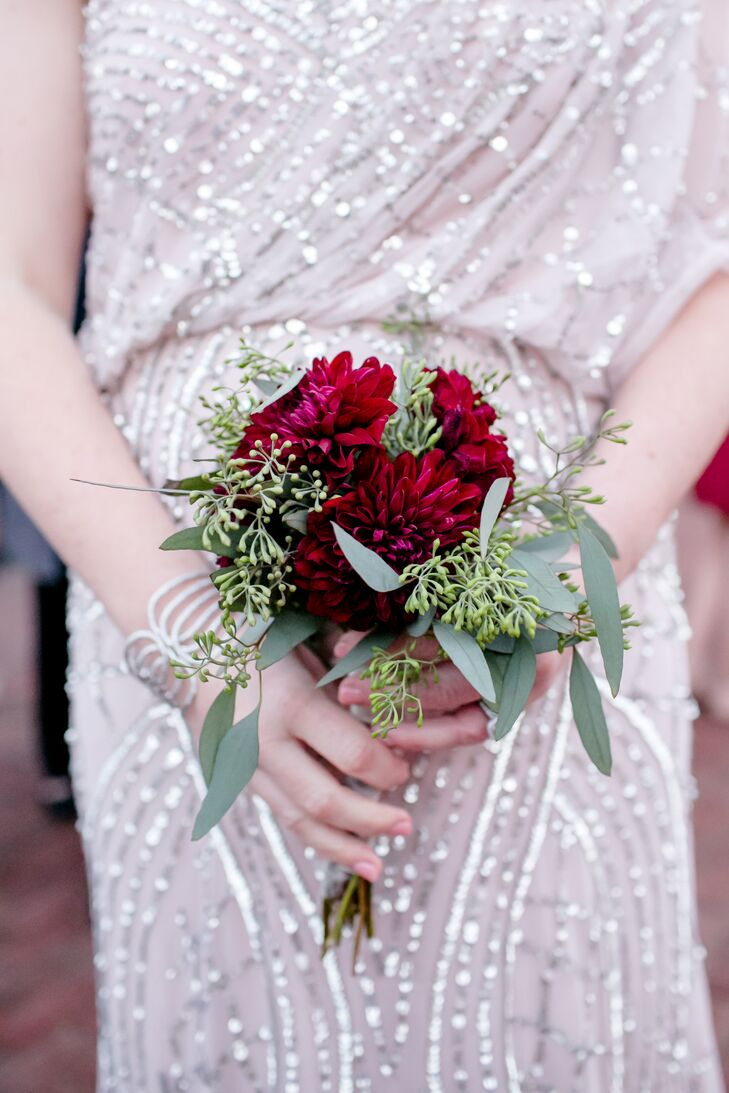 """""""For each bridesmaid, I chose a flower that had a meaning related to her soul,"""" Maggie says. """"Yes, very cheesy, but this made the whole process meaningful and fun."""" Bridesmaid bouquets incorporated green seeded eucalyptus (symbolizing spiritually) and a flower that represented that bridesmaid."""