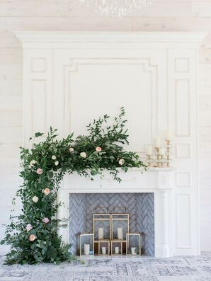 Romantic White Fireplace with Greenery and Candles