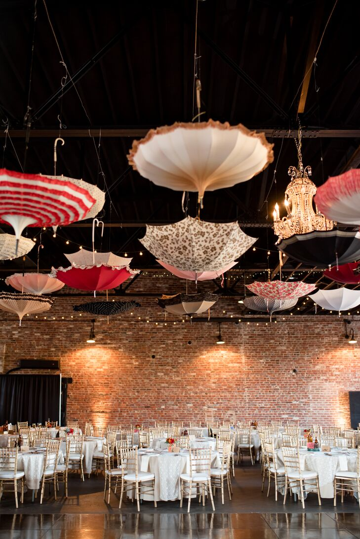 Colorful umbrellas were hung upside down from the ceiling, bringing a whimsical vibe to the celebration at Inn at the Old Silk Mill in Fredericksburg, Virginia.