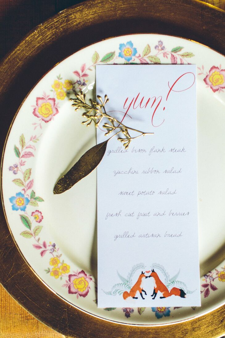 Menu cards topped the floral china with yum! spelled out in looping text.