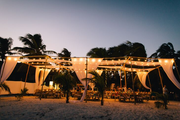 Draped Beach Reception With String Lights