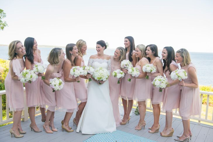 Dressed in knee-length dresses (except for the maid of honor), the bridesmaids wore light pink Amsale in varying styles and with different shoes. Their bouquets were primarily white florals with touches of blush.