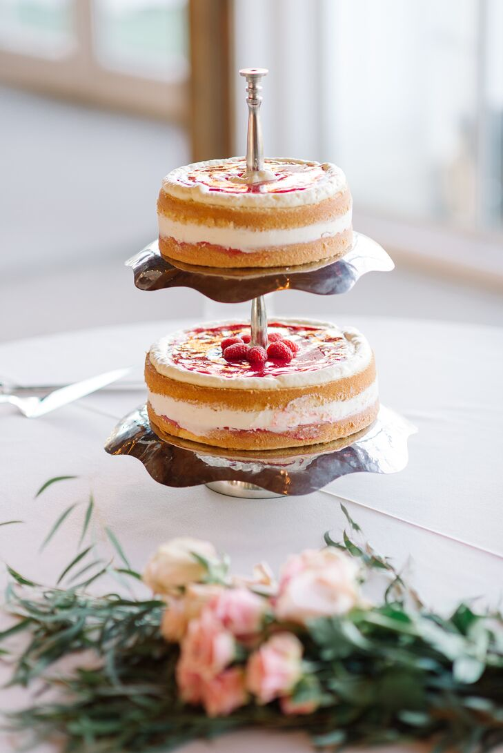 """Emma's friend baked the couple a lemon-flavored cake with raspberry jam filling. """"We really wanted a naked cake topped with flowers, and that's what we got,"""" Haleigh says."""