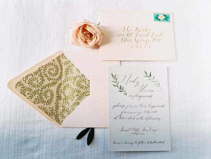 Guests received white invitations with black calligraphy; their rosemary designs added a natural touch. Blush envelopes with gold paisley liners sealed the invitations inside, creating an overall elegant package.