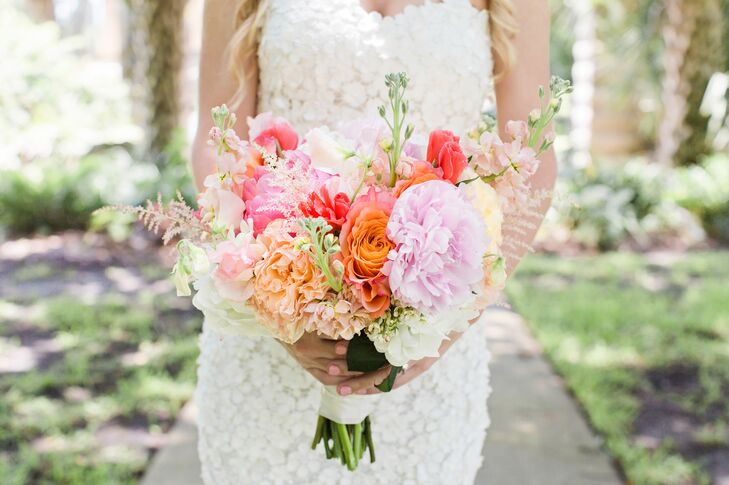 "Kellie carried a bouquet brimming with garden roses, peonies, wax flowers and stephanotis. ""The stephanotis flower was chosen for my bouquet and Ryan's boutonniere because the flower resembled the flower appliques on my wedding dress,"" Kellie says."