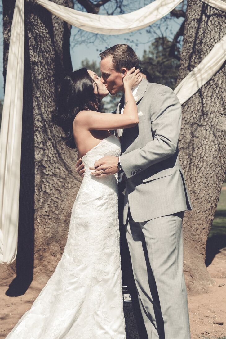 Sarah and Kolton shared their first kiss next to trees wrapped in white linens.