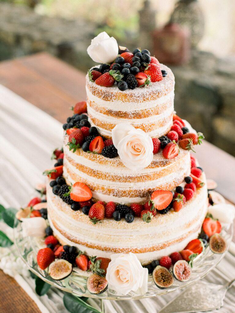Simple naked wedding cake with fresh fruit
