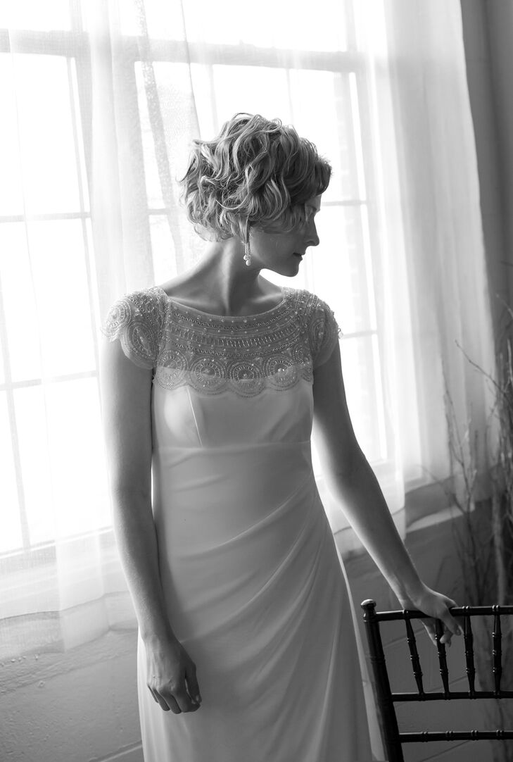 Heidi wore a scalloped cap sleeve floor length gown with a leaded illusion panel at the neckline and sleeves.