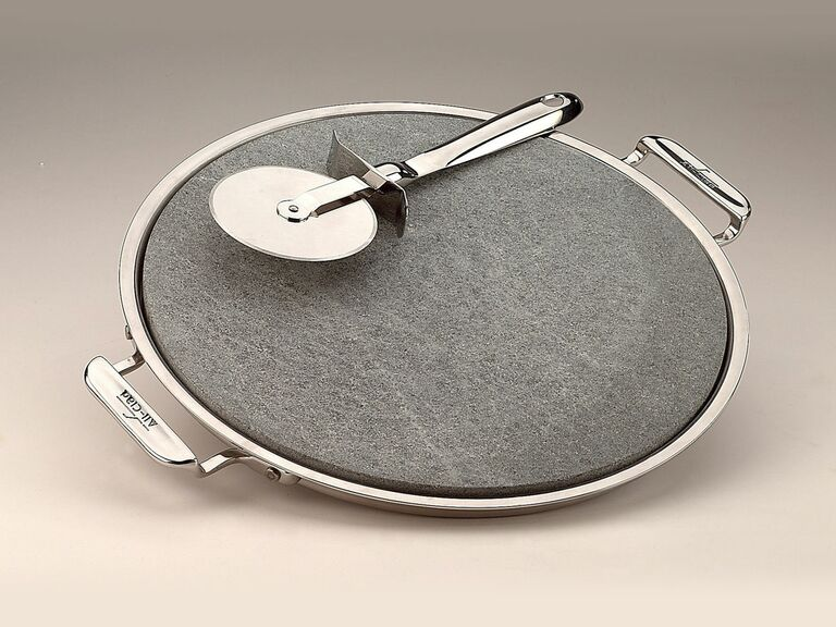 pizza stone with metal cutter and serving tray