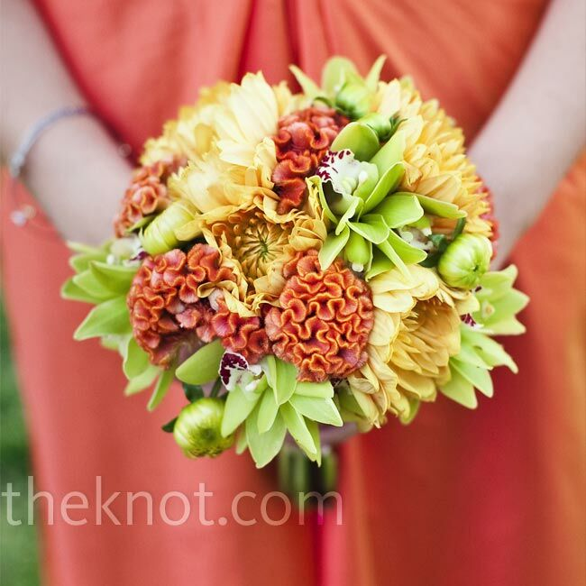 The bouquets consisted of orange dahlias, celosia and small green orchids.