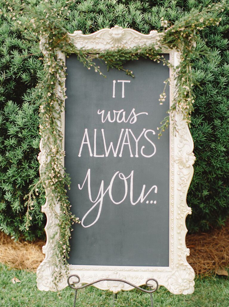 elegant chalkboard wedding sign displaying romantic quote