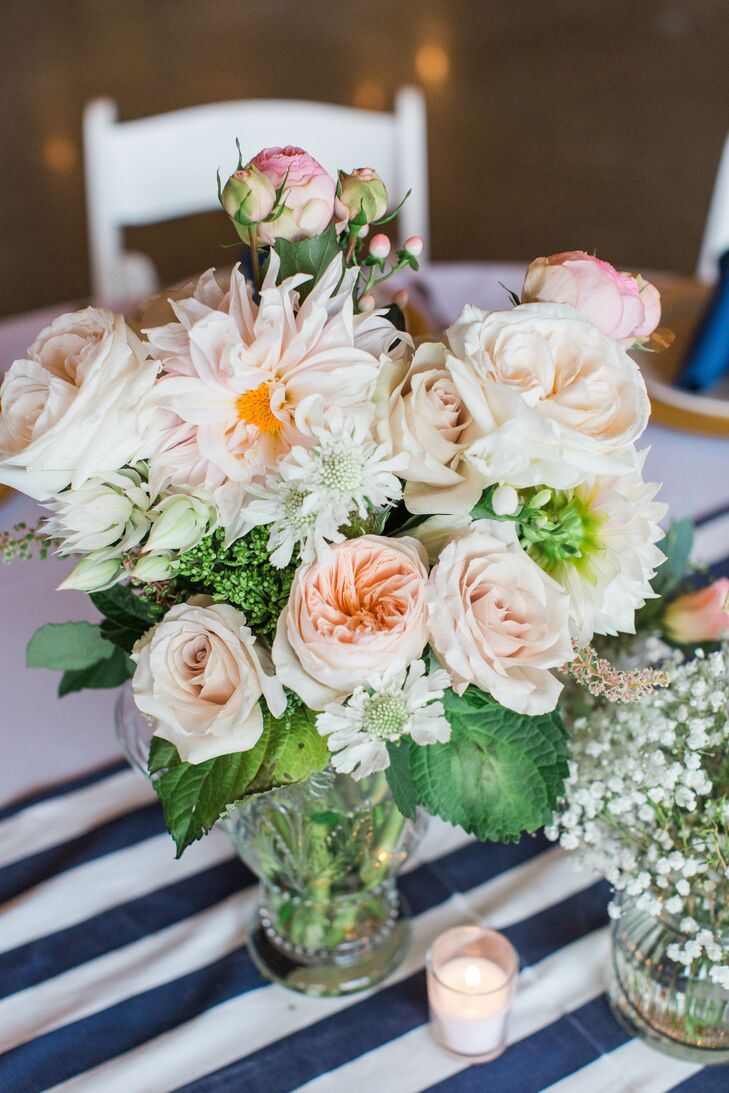 The bouquets contained white garden roses, anemones, ranunculus, touches of dusty miller, dusty mint leaves, pink garden roses and spray roses, white pearl yarrow and just a touch of blue viburnum berries.