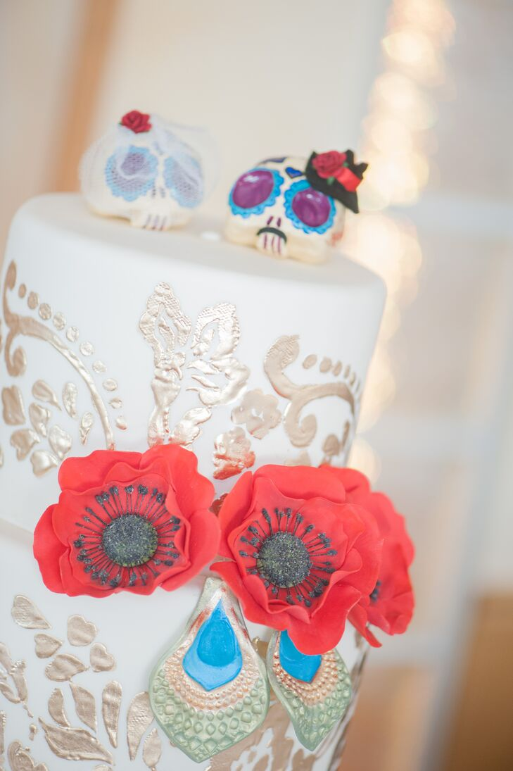 A friend of the couple's created the Dia de los Muertos-inspired skull cake toppers!