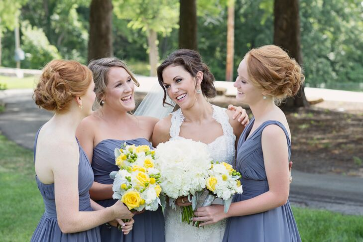 The bridesmaids wore gray ruched dresses with different necklines.