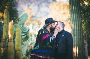 Glamorous Same-Sex Couple with Colorful Tassel Jacket and Sparkly Hat