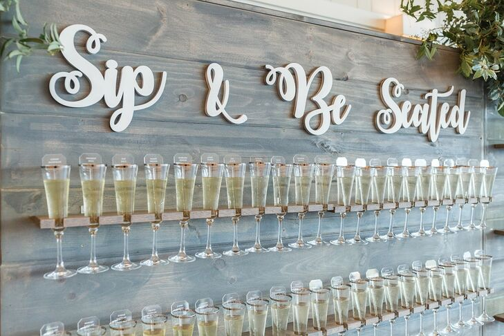 Champagne Wall Escort Cards with Whimsical Signage