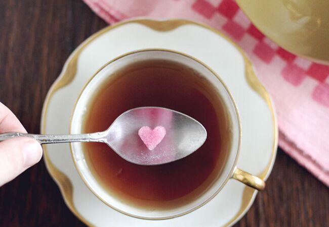 Heart shaped sugar cube with tea