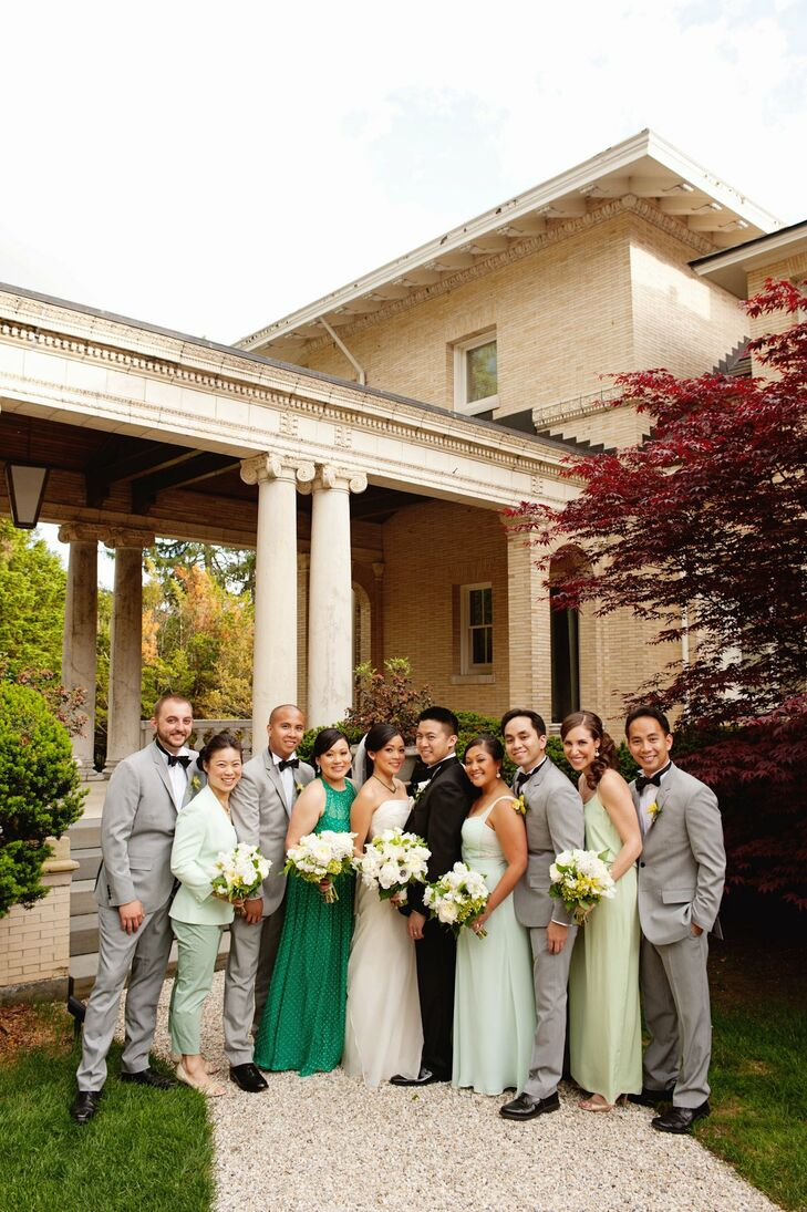 Fanny chose a mix-matched look for her bridesmaids. Each girl wore a formal floor-length gown in their a style of their choice, each in a different shade of green. Brian's groomsmen wore pale gray suits, black bow ties and white tuxedo shirts.