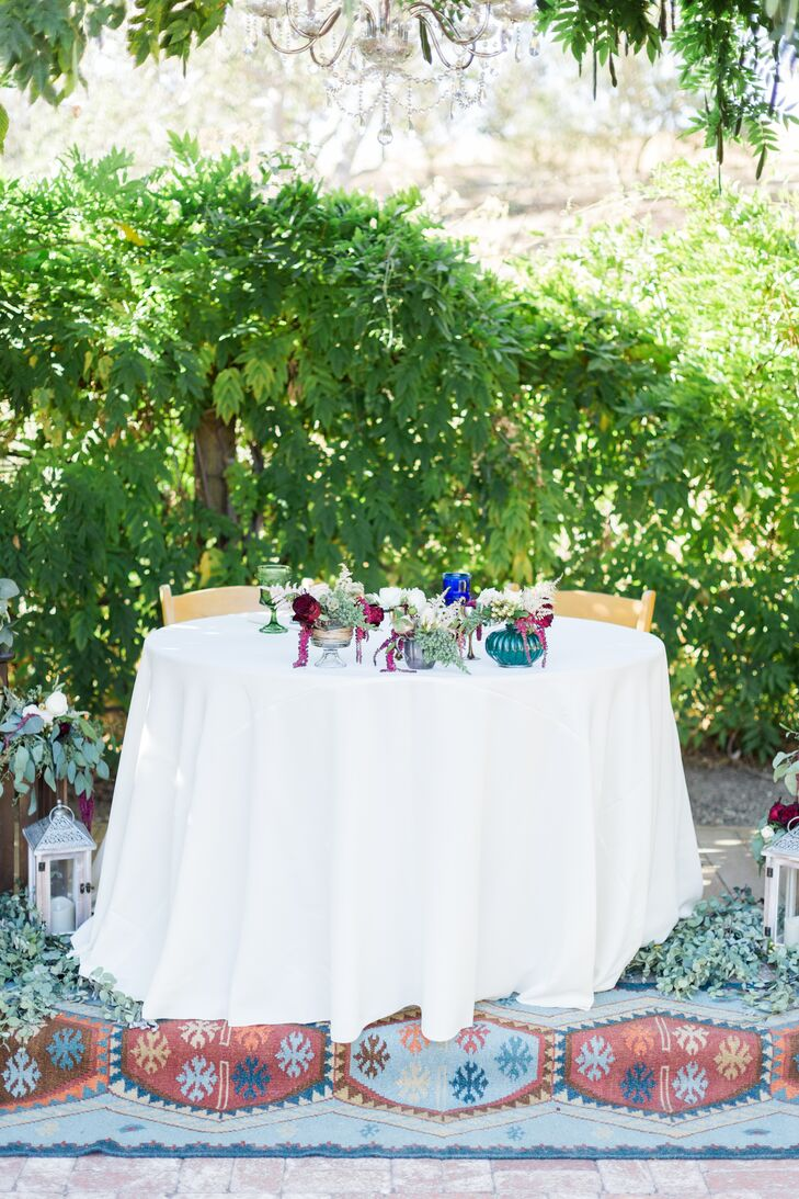 """I wanted to add some color to the tables, so I decided to rent miscellaneous-colored goblet glasses for water and wine,"" Jenna Mae says. ""The mismatched colors kept the bohemian theme I was going for and also blended nicely with all the garden flowers."""