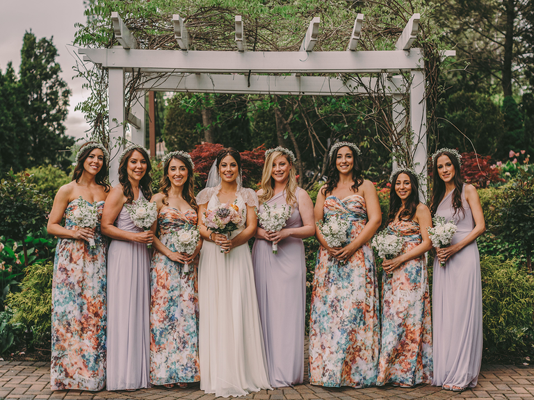 ec629562d7157 Bride with bridal party floral bridesmaid dresses