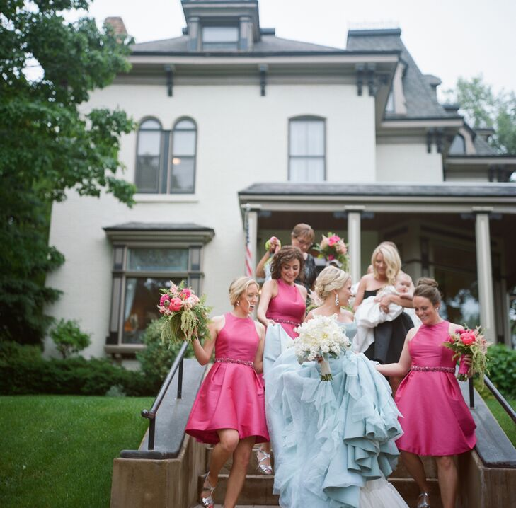 The bridesmaids donned knee-length fuchsia Monique Lhuillier gowns for the pink and gold wedding. They completed their look with crystal sashes and strappy silver heels. Their cascading pink and green bouquets brought the Shakespearian theme into the overall look.