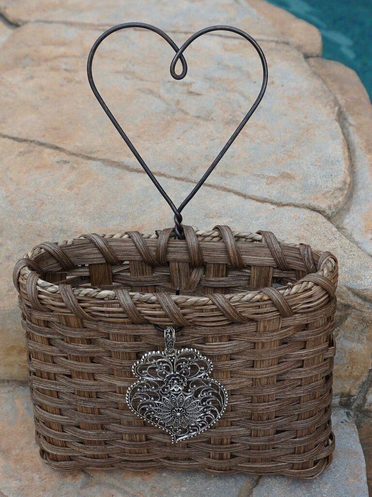 woven flower girl basket with metal heart handle