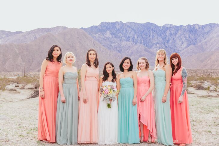 The bridesmaids wore floor-length dresses in a variety of styles and soft colors. Liz loved the idea of the elegant, pink and pastel dresses against the desert backdrop.