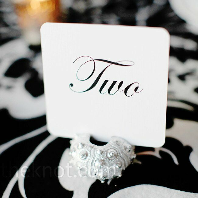 Simple black and white table number cards were displayed inside real sea urchins painted silver.