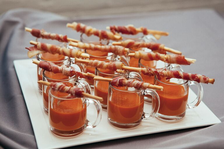 Tomato Soup Shooters Served With Bacon On A Stick
