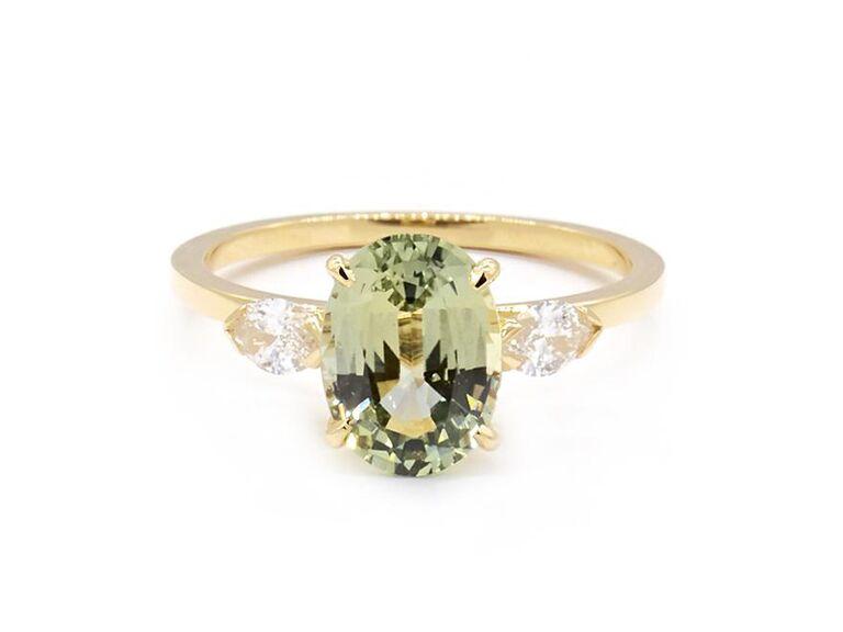 Green sapphire three-stone engagement ring