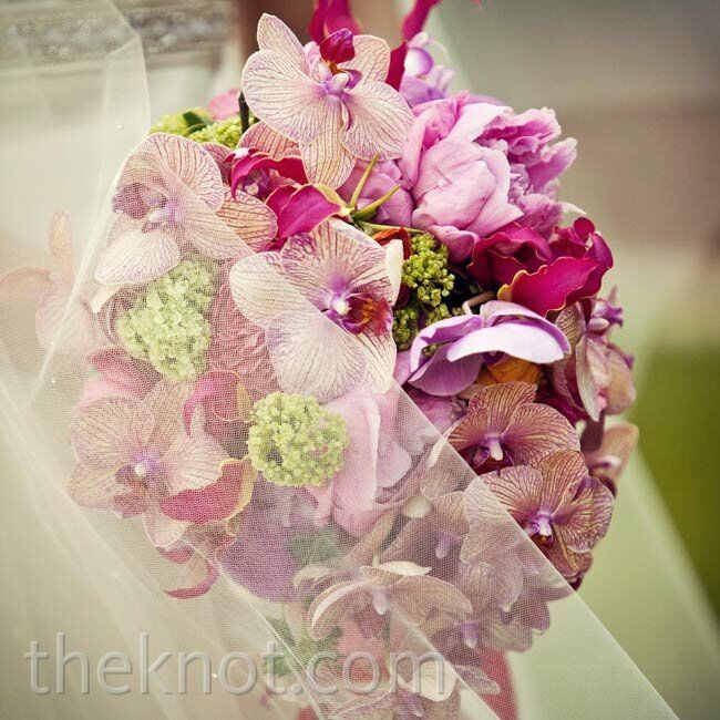 Subtle green accents punctuated Celia's exotic pink-and-purple orchid arrangement.