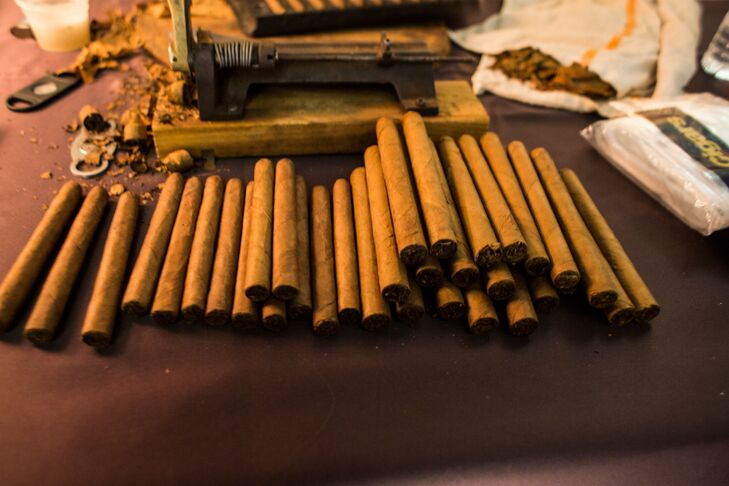 """At the sangeet ceremony, a professional rolled cigars by hand. """"There was always an activity for our guests to enjoy,"""" Patricia says."""