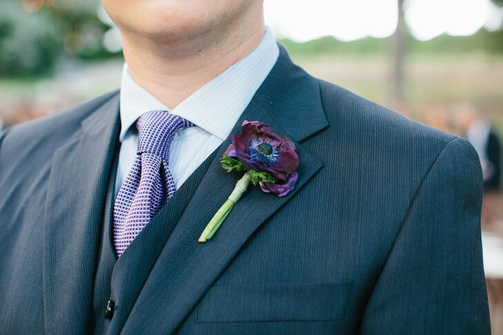 Eddie's boutonniere was a single dark-purple anemone that mimicked the color of Jessica's bouquet.