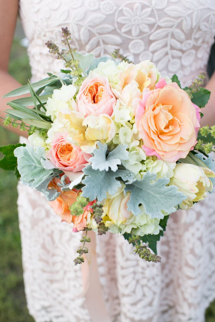 The bouquets had a distinct whimsical and romantic vibe, filled with pale pink, peach and ivory blooms like garden roses, tulips and hydrangeas, as well as wispy greenery and dusty miller.