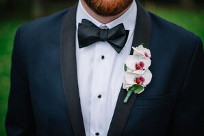 White Orchid Boutonniere with Pink Center