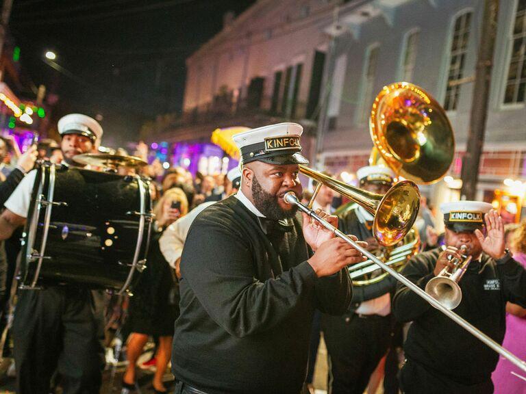 Mardi Gras-inspired musical parade at wedding reception
