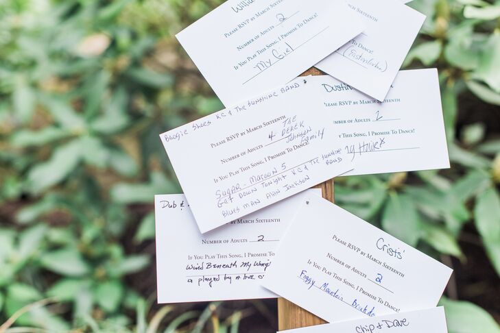 "On their RSVP cards, Jordan and Austin asked guests to write down a song that would get them out on the dance floor. Their friends and family obliged and on the day of the wedding, the couple pinned the song requests on a ladder for everyone to read during cocktail hour. ""I loved this aspect of our wedding because it allowed everyone to see the funny comments and different song choices!"" says Jordan."