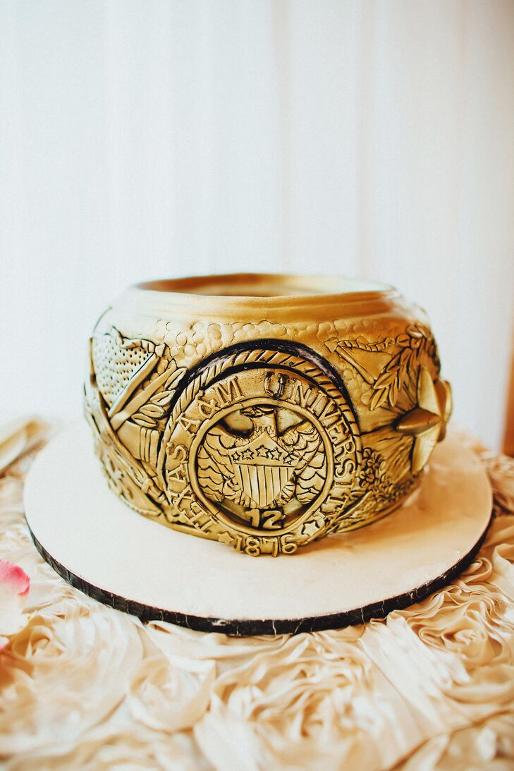 Talk about bling! In case there was any question about Courtney and Andrew's love for Texas A&M, the groom's cake was a replica of the Aggie ring. Cakes and More created the confection, covered in metallic gold fondant.