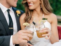 Bride and groom with signature cocktails