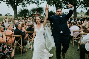 Couple Recessing at Rustic Outdoor Ceremony