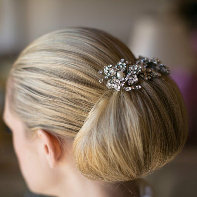 Casey's hairstylist pulled her hair back into a sleek full bun and accented it with a crystal hair pins.